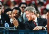 Presidential candidate Bill Clinton speaking with Rev. Jesse Jackson at a campaign stop on welfare...