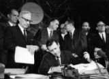 Governor Sanders signs in an apportionment bill re-evaluating voting districts, 1965