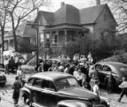 Crowds gather after the Columbians threaten an African-American family moving in to a...