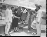 Golfer Louise Suggs at the airport with friends and family, 1948