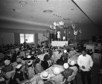 Luncheon guests watch the Rich's department store fashion show, 1960