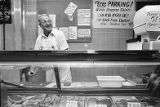 Owner Charlie Hazelrigs running the counter at Shields Market, 1978