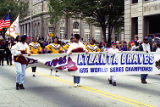 Students carrying the Atlanta Braves World Series Champions banner leading the victory parade, 1995