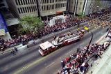 Baseball fans line the streets downtown during the celebratory parade for the Atlanta Braves world...