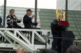 Atlanta Braves owner Ted Turner and Jane Fonda ride with the World Series trophy during the...
