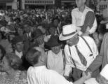 Supporters meet with Governor Ellis Arnall during a campaign stop, 1944