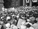 Crowds gather to welcome Governor Ellis Arnall during a campaign stop, 1944