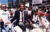 Mayor Andrew Young with his wife in Atlanta's celebratory parade for the winning Olympics bid, 1990