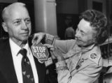 Stop ERA Georgia member Katherine Dunaway pinning a badge on W. M. Goodson, 1979