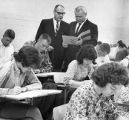DeKalb College Presidents Dr. Hollingsworth and Jim Cherry among a group of students, 1964