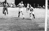 Atlanta Chiefs Rookie of the Year Kaiser Motaung slips behind two defenders against the Cleveland...