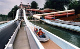 Guest ride rafts down the Ragin' River waterslide at Six Flags Over Georgia, 1991