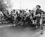 Racers take off from the starting line of the Peachtree Road Race, 1970s