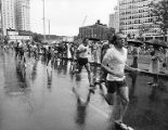 Racers battle rainy weather during the Peachtree Road Race, 1974