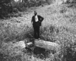 Moore's Ford Bridge mass lynching, July 25, 1946. Unidentified man pointing his cane at hole,...