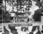 "M. E. Thompson performers with a ""It's Thompson Time"" sign, 1954"