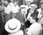 Gubernatorial candidate M. E. Thompson meets with supporters during a campaign rally, 1954