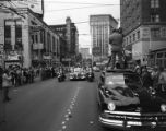 Crowds cheer as presidential candidate Richard B. Russell parades through Five Points, 1952