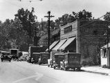 Cars parked along the storefronts in the Virginia-Highlands area, 1936