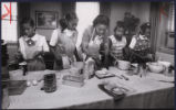 Girl Scouts making bread with Mary Scruggs, Atlanta, Georgia, March 1978.