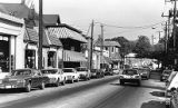 Cars parked along storefronts in Virginia Highlands, 1987