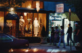 Storefront for Jules Jewels with Jimmy Watson's Barber Shop sign above the door, 1993