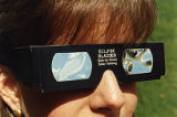 Woman models protective eyewear necessary for viewing solar eclipses, 1991