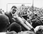 Crowds swarm Wilt Chamberlain as he arrives for the funeral of Martin Luther King Jr., 1968