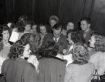 Governor M. E. Thompson signs autographs for a group of teenagers, 1947