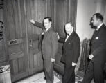 Governor M. E. Thompson knocking on a door, 1947
