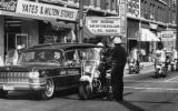 Police escort the body of Martin Luther King Jr. down Auburn Avenue during the funeral procession,...