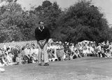 Golfer Arnold Palmer watches his putt during the Ryder Cup tournament, 1963