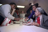 Civil rights worker Rosa Parks signing autographs after speaking at the Women and the Constitution...