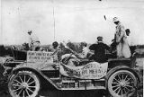 Automobile displaying Good Road Tour signage, 1910