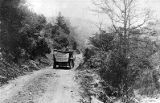 Pathfinder automobile during the Good Roads Tour scouting out passageways, 1910