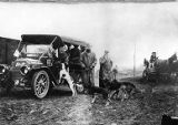 Good Roads Tour automobiles greeted by bloodhounds during a pitstop, 1910