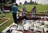 Atlanta Urban Gardening volunteers help create a community garden at the East Lake Meadows public...