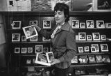 Esther LeFever displaying handmade Cabbagetown tiles, 1983