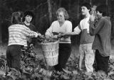 Foster parent Doris Strickland farming with a few of her foster kids, 1988
