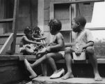 African American children on front porch of a rental house on Capitol Avenue in Peoplestown,...