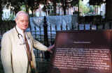 County coroner Dr. James C. Metts with the placard of Casimir Pulaski, 1998