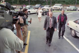 Investigators arriving at Richard Jewell's apartment for questioning in the Centennial Olympic...