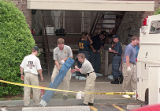 Investigators set up an area to look through potential evidence at Richard Jewell's apartment, 1996