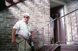 Richard Jewell attempts to leave his apartment surrounded by journalists questioning his...