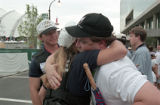 Centennial Olympic Park security guard Richard Jewell receiving a hug from a police officer after...
