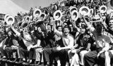 Fraternity members cheer on the Yellow Jackets from the stands, 1957