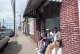 Residents taking a break in front of a store in the Summerhill neighborhood, 1995