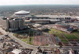 Aerial view of Centennial Olympic Park with the CNN Center and Georgia Dome, 1999