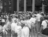 Crowds gather to watch the murder trial of John Wallace outside the Newnan courthouse, 1948
