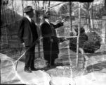 Asa G. Candler visiting the ostrich exhibit at the Candler Zoo, 1930s